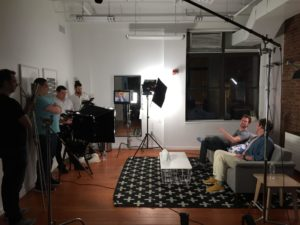 video production crew filming an interview